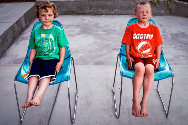 Twin boys sitting in chairs during San Francisco Family Photography session in Corte Madera, CA
