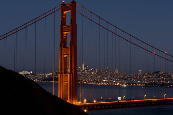 View of Golden Gate Bridge with San Francisco city skyline in the background.