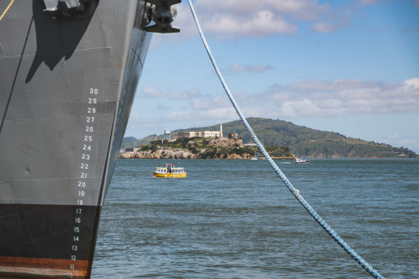 View of Alcatraz and tug boat in San Francisco Bay
