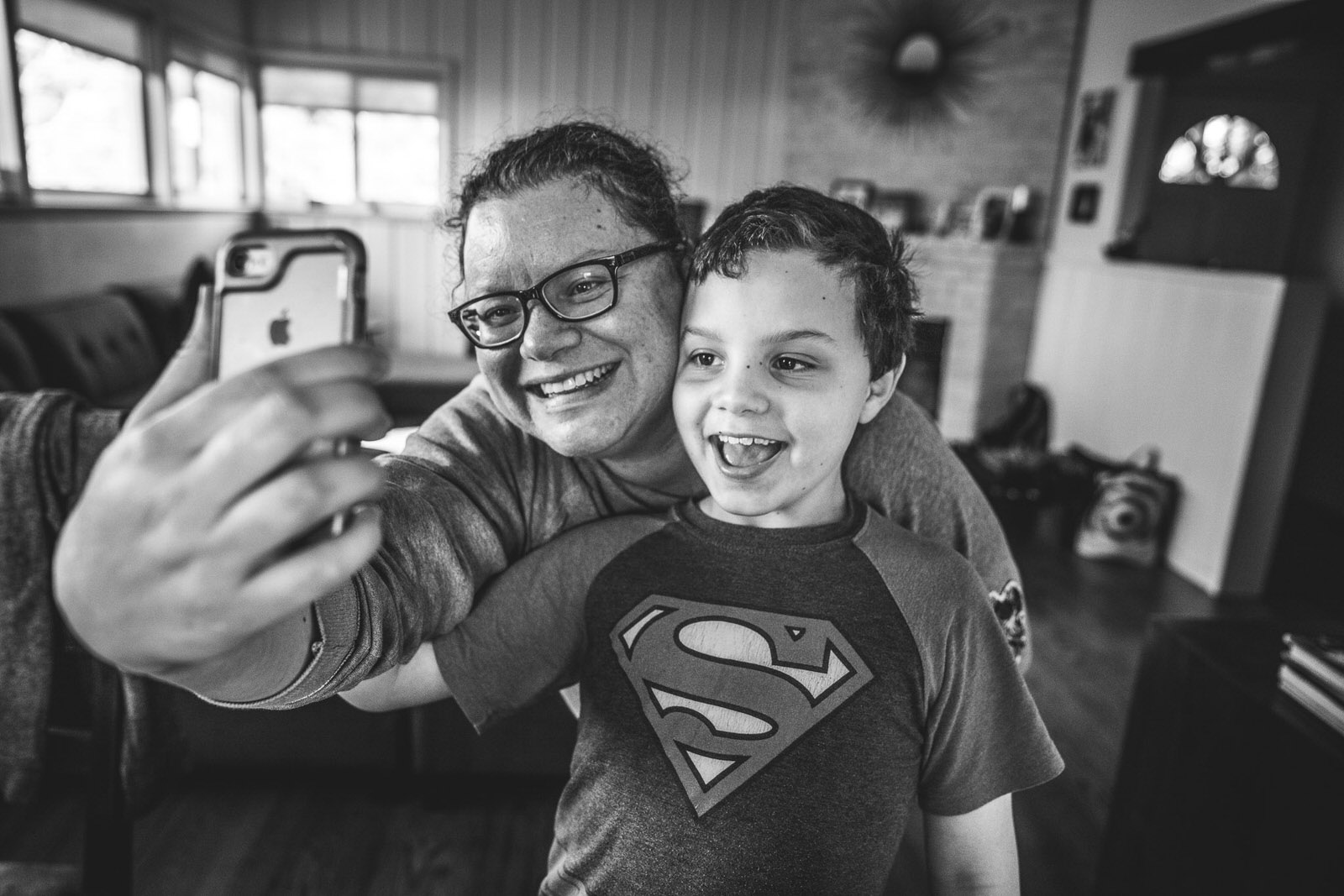 Photo by Sam Hines of Lisa Winner taking a selfie with her son