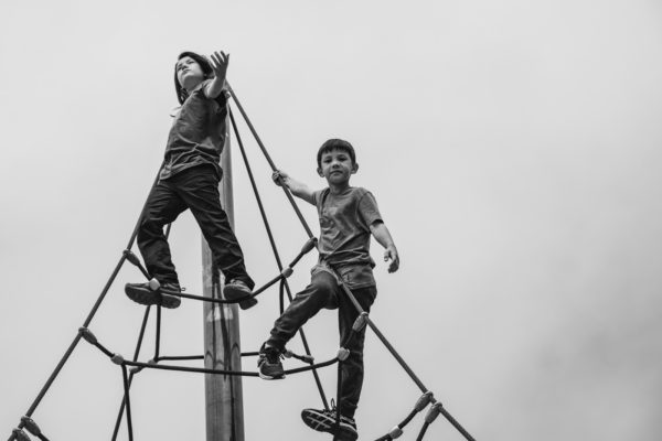 Two young boys stand at the top of a play structure in Golden Gate Park during a San Francisco Family Photography Session