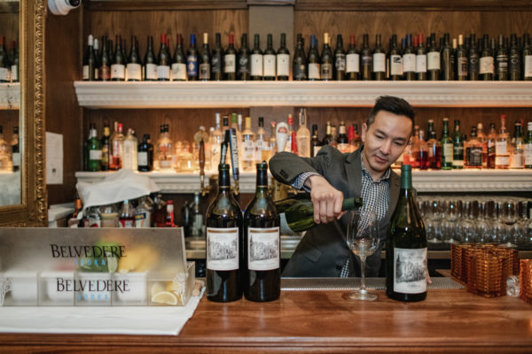 Restaurant manager pours wine at the historic John's Grill