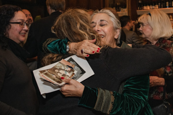 Guests hug as they arrive at the NCCA retirement dinner at the John's Grill in San francisco
