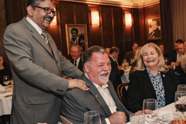A speaker laughs with Jim, a retiree at the NCCA retirement dinner at John's Grill in San Francisco