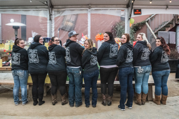 Woman show off their hoodies during at fundraiser at Lagunitas Brewing