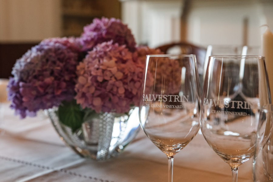 Salvestrin Winery glasses on dinner table for Thomas Arvid artists dinner in Napa Valley, CA