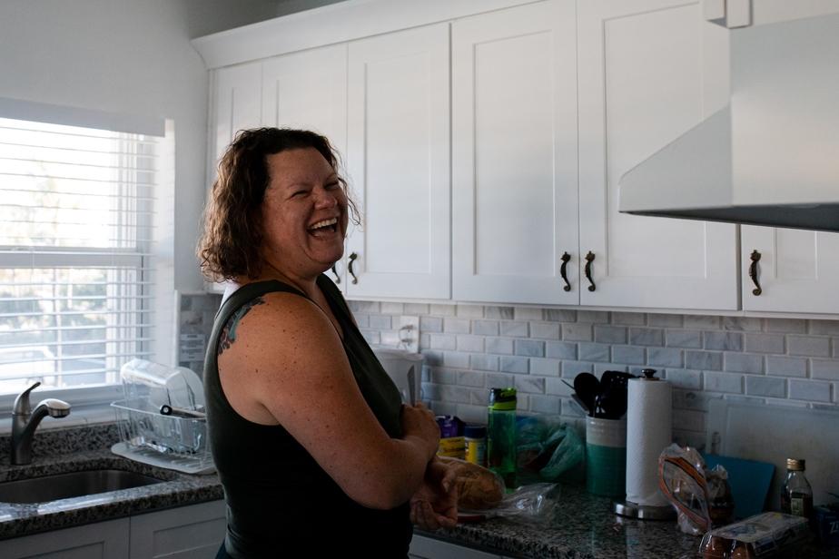 Lisa Winner laughing in a kitchen in Marathon, FL