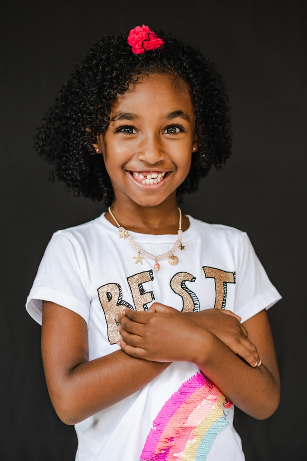 Young girl holding her arms during Alameda School Portraits