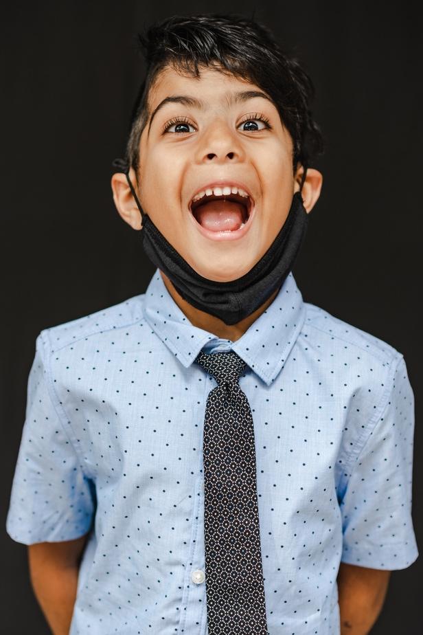 Young boy posing for school photos in Oakland, CA
