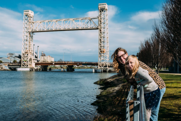 A mom and daughter looking at the water in Alameda, CA