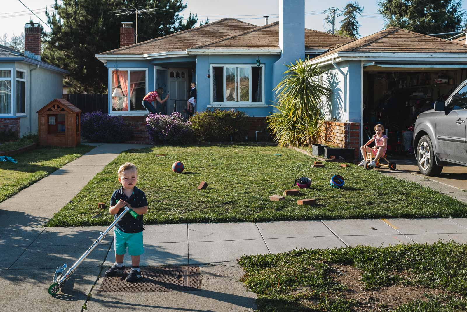 A family stands in front of their home in Alameda, CA