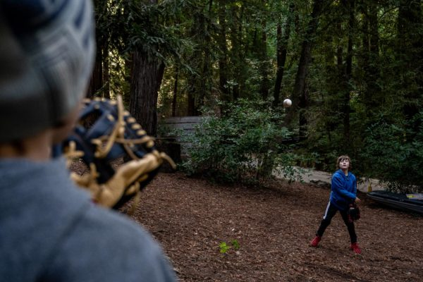Two boys play catch while camping at Ventana Campground in Big Sur, CA