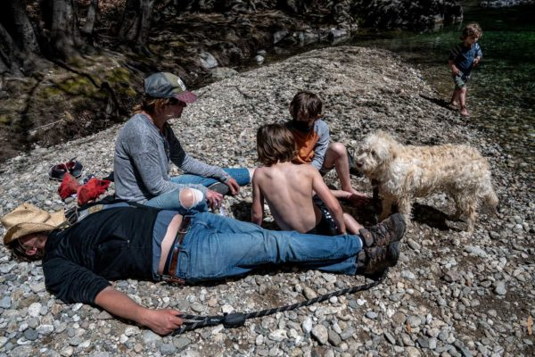 A family rests on the shores of Pfeiffer State park in Big Sur, CA