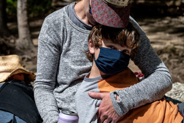 A mom cradles her son at Julia Pfeiffer State Park in Bug Sur, Ca