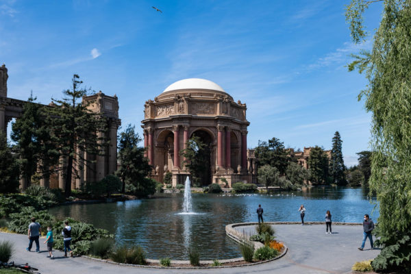A family spends time at the Palace of Fine Arts in San Francisco, CA
