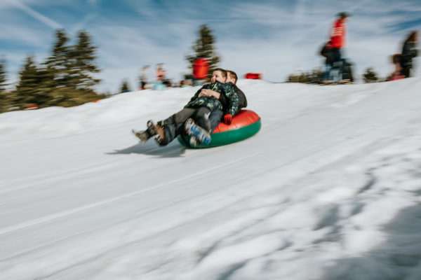 A father and son slide down a tubing hill in Lake Tahoe, CA