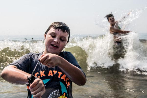 Two children enjoy the waves at Stinson Beach, CA