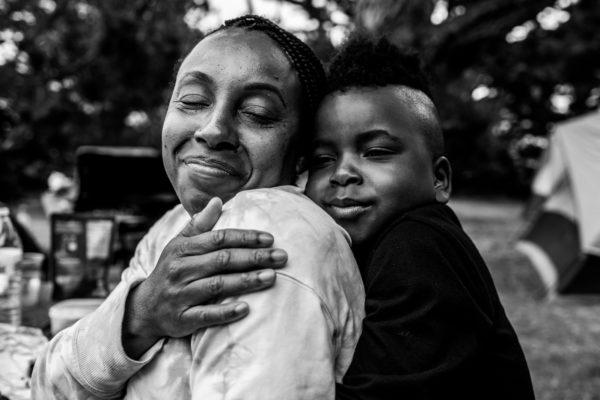 Mom and son hug while camping in Santa Cruz, CA