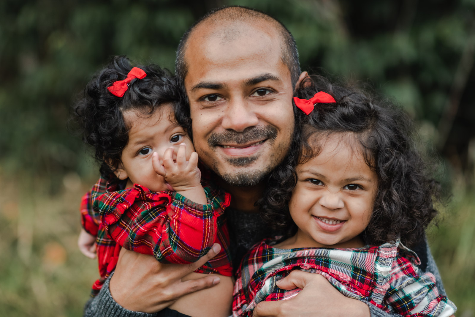 Father with his two daughters during holiday mini photo session in San Francisco, CA