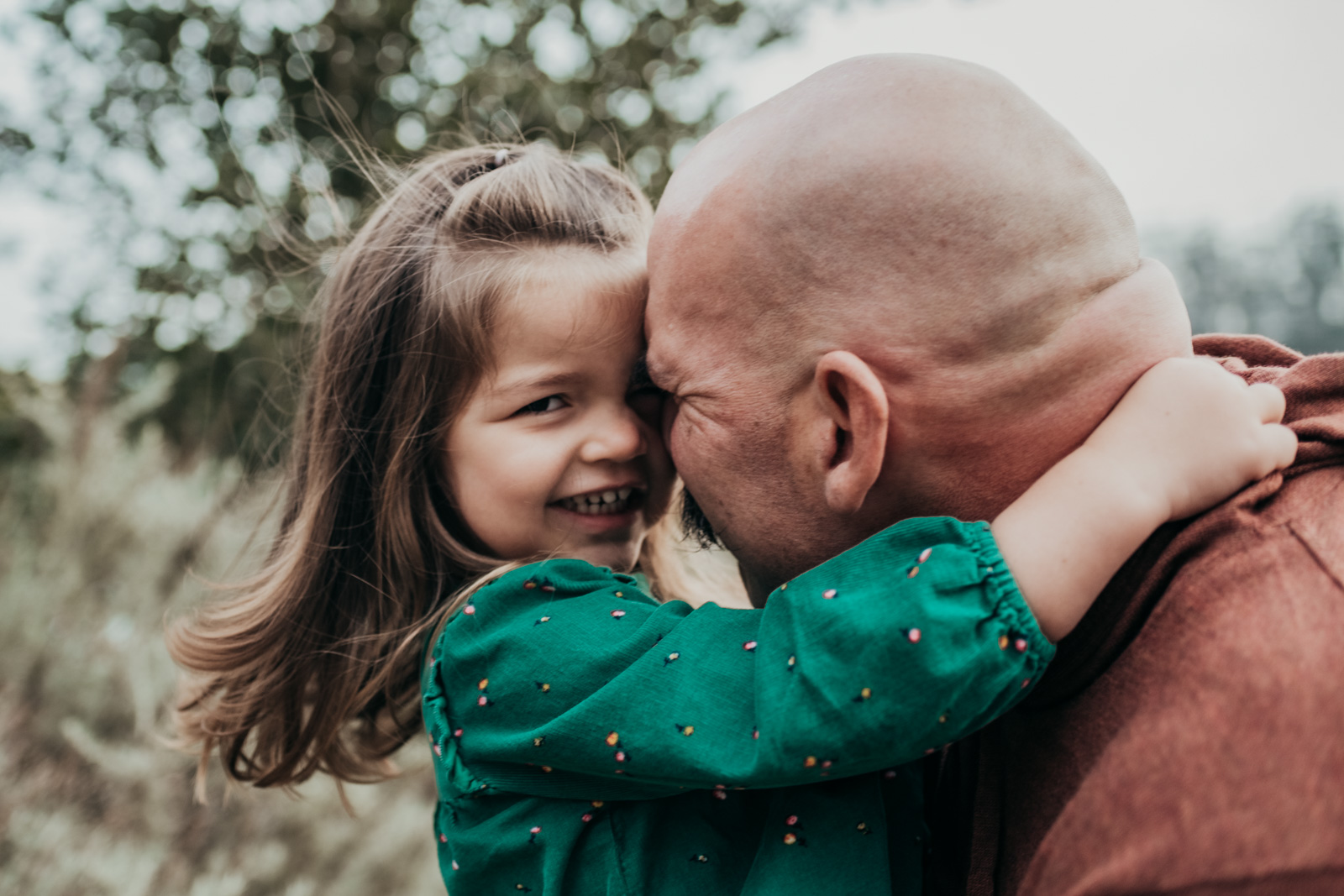 Daughter hugs her Dad during holiday mini photo session in San Francisco