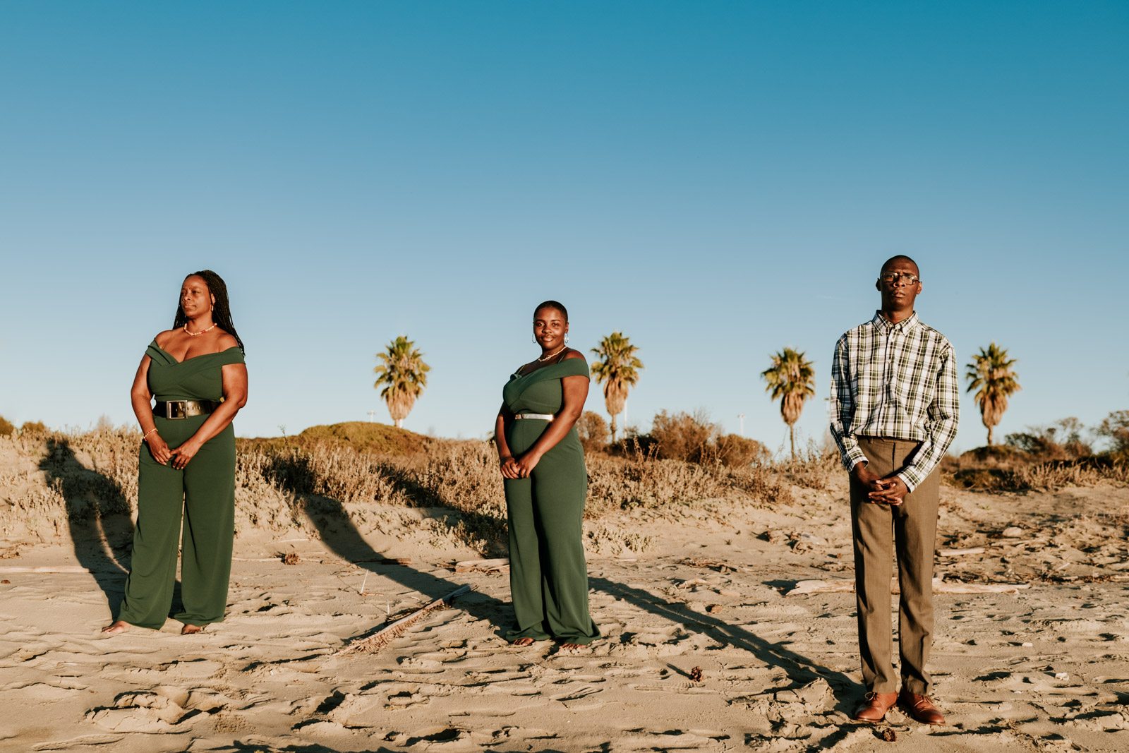 Family stands on the beach in Alameda during a family photo session